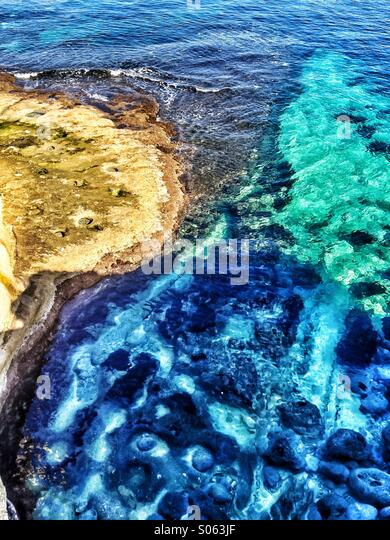 Aerial view of limestone rocks and sea - Stock Image