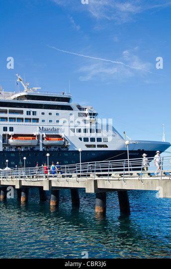 Holland America Maasdam at Roseau Dominica tourists on cruise ship pier Eastern Caribbean cruise port - Stock Image