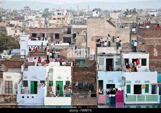 Indian people flying kites from the rooftops. Kite Day Festival. Jaipur. Rajasthan. India - Stock Image