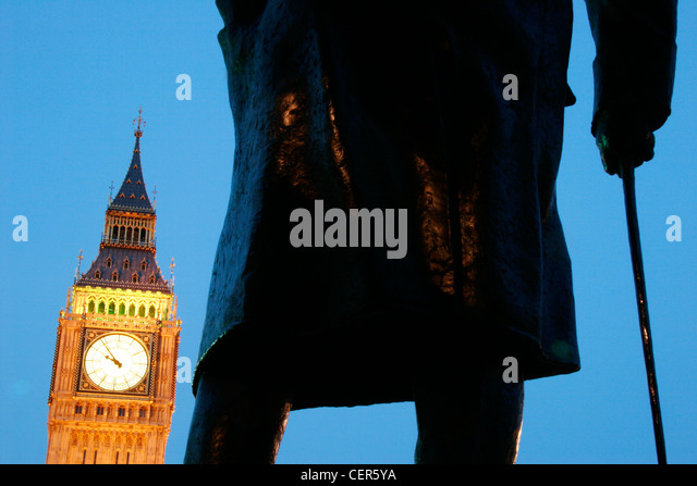 Big Ben framed by a statue of Winston Churchill. - Stock Image