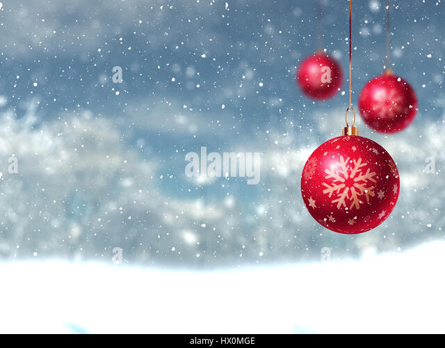 Defocussed Christmas winter landscape with hanging baubles - Stock Image