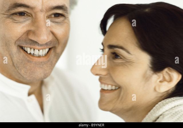 Mature couple together, smiling - Stock Image