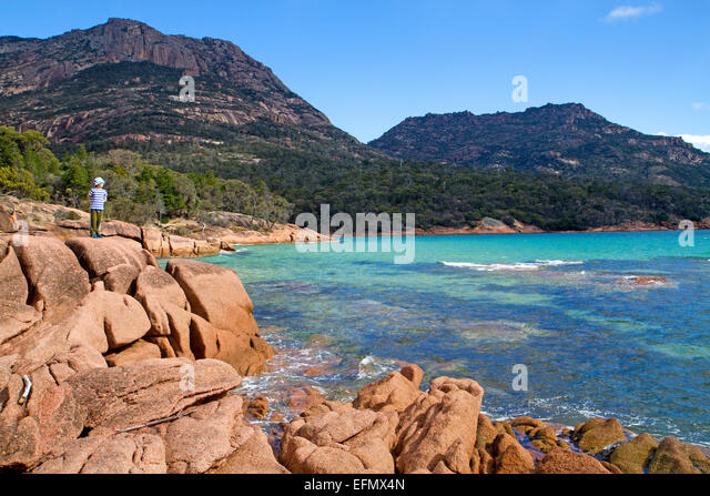 Boy at Honeymoon Bay, at the foot of the Hazards - Stock Image