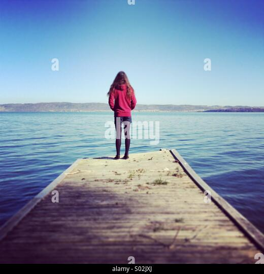 A lady in a pier - Stock Image