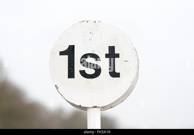 A first place marker sign at a horse racing track - Stock Image