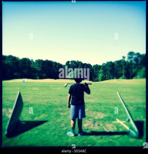 Boy golfer - Stock Image
