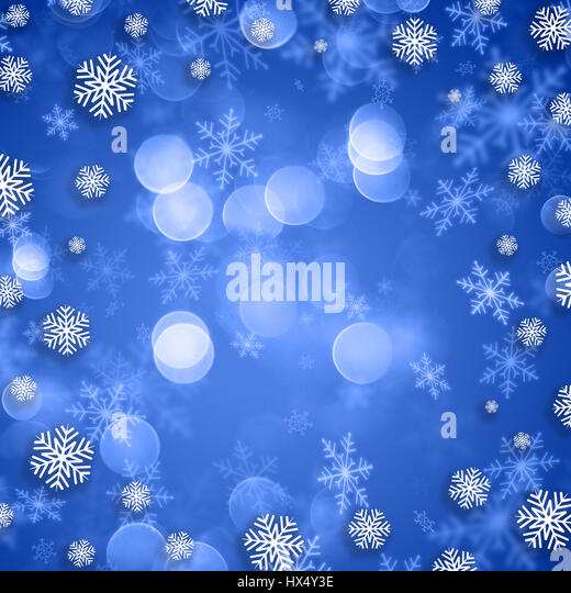 Snowflakes on a blue Christmas background - Stock Image
