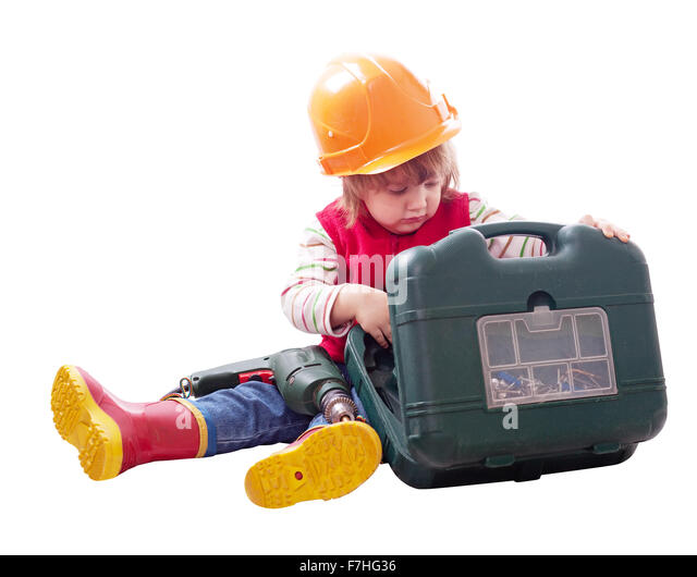 2 years child in hardhat chooses tools in toolbox. Isolated over white background - Stock Image