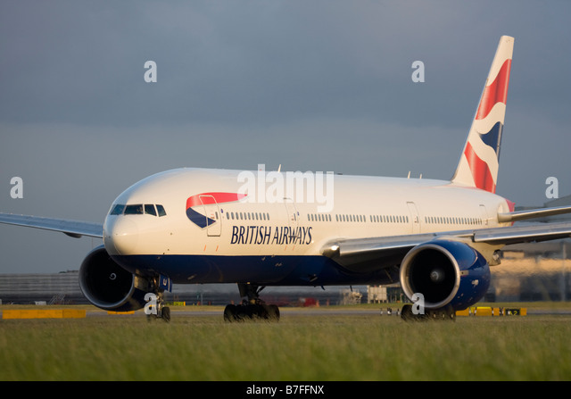 British Airways Boeing 777-236/ER taxiing for departure at London Heathrow airport. - Stock Image