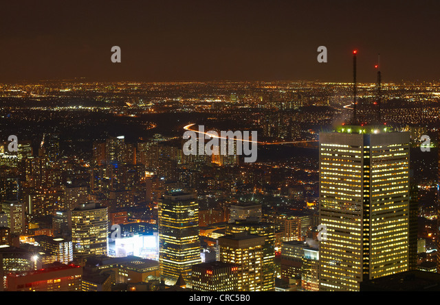 Aerial view of Toronto lit up at night - Stock Image