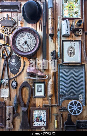 Various implements and utensils of the twentieth century at the House of Alijn museum, Ghent, Belgium - Stock Image