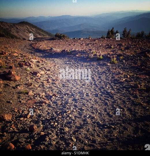 About 9000 ft up, hiking on Mount Shasta in California during a September sunset. - Stock Image
