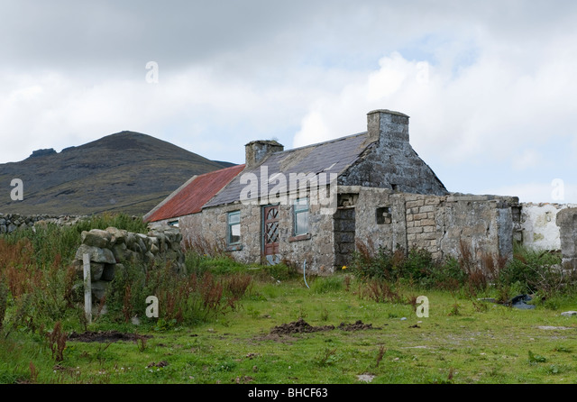 Empty And Ramshackle Cottage In The Mountains Stock Photos