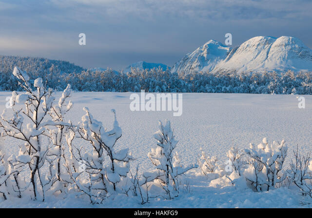 Snowy Winter Landscape with Mountains in Breivikeidet, Troms, Norway - Stock Image