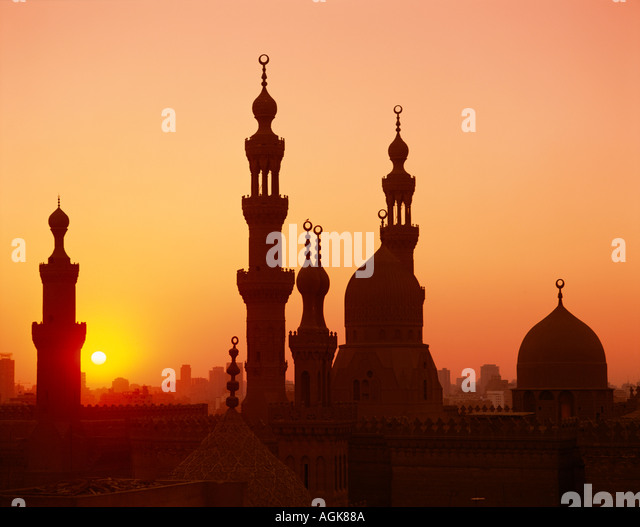 Domes and minaretes at sunset Cairo Egypt - Stock Image