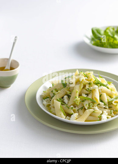 Bowl of pasta with cheese and herbs - Stock Image
