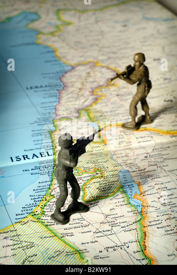 Toy soldiers on map of Middle East and Israel face off - Stock Image