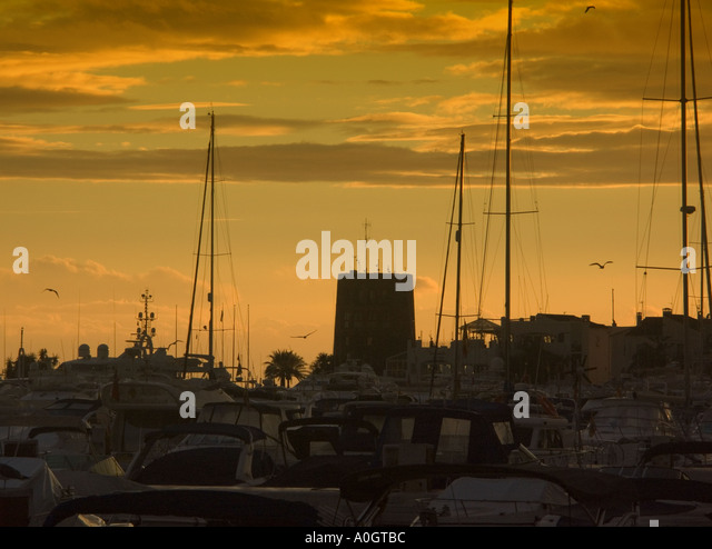 Puerto Banus sunset Costa del Sol Spain sunset sunsets watchtower watchtowers tower towers playground of the rich - Stock Image
