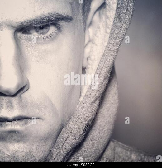 Angry male looking at camera with copy space - Stock Image
