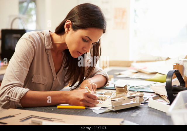 Female Architect Making Model In Office - Stock Image