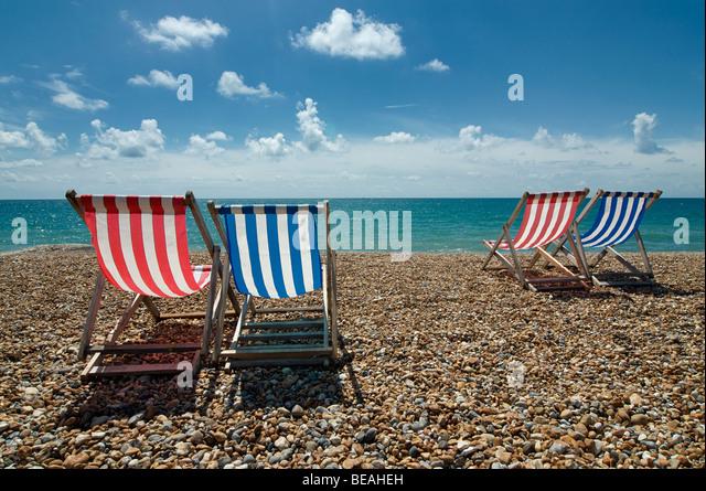 Empty deckchairs on Brighton beach, England - Stock Image