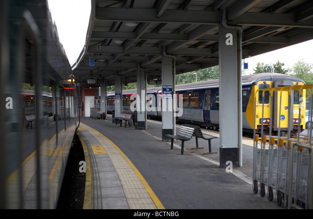 trains on empty platforms in belfast central station northern ireland - Stock Image