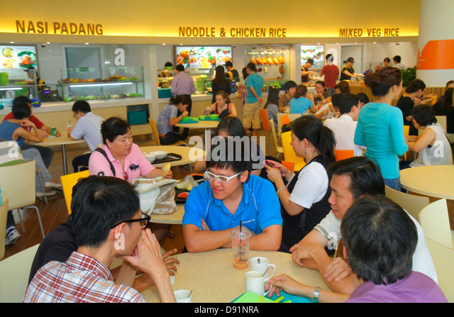 Singapore National University of Singapore NUS University Town school student campus Asian man woman food court - Stock Image