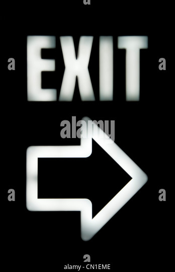 EXIT Sign with Arrow on Black - Stock Image