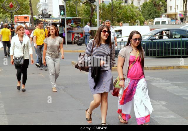 Chile Santiago Providencia Avenida Vicuna Mackenna major artery Hispanic woman man pedestrian walking young adult - Stock Image