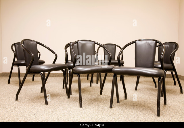 Empty chairs in a meeting room - Stock Image