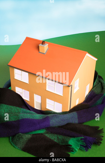Keeping house warm concept. - Stock Image