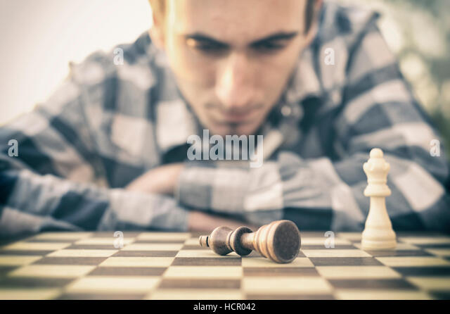 Man playing chess - Stock Image