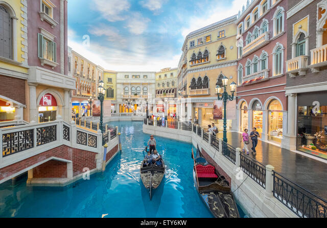 Canal and Gondola on canal inside The Venetian Macao  casino and hotel in Macau China - Stock Image