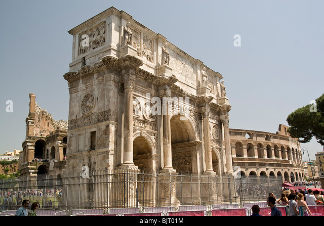 Italy, Rome, Arco di Costantino The Colosseum in the background - Stock Image