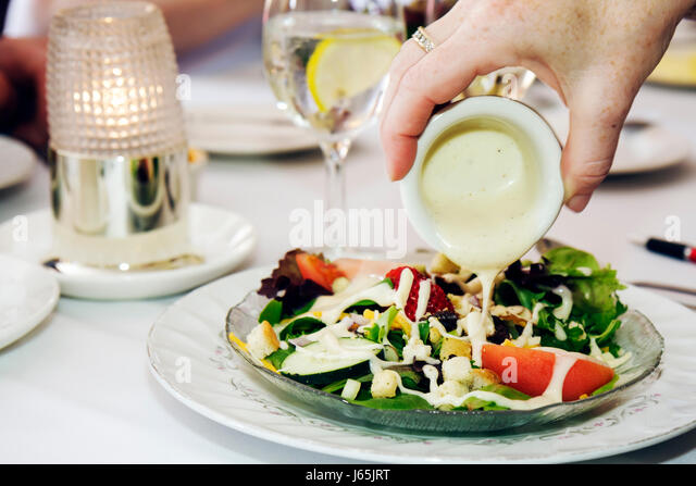 Saginaw Michigan Montague Inn bed & and breakfast lodging historic home restaurant fine dining food table mixed - Stock Image