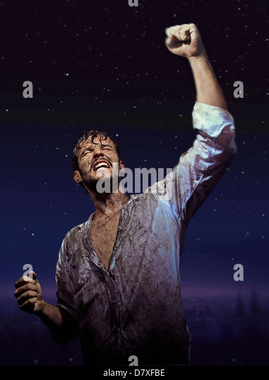 Brave dirty man in glory pose - Stock Image