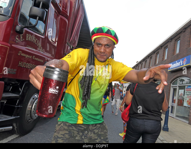 Costumed dancer with hat from Huddersfield Carnival 2013 African Caribbean parade street party - Stock Image