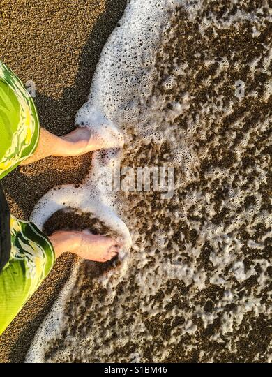 Feet at the beach point of view - Stock Image