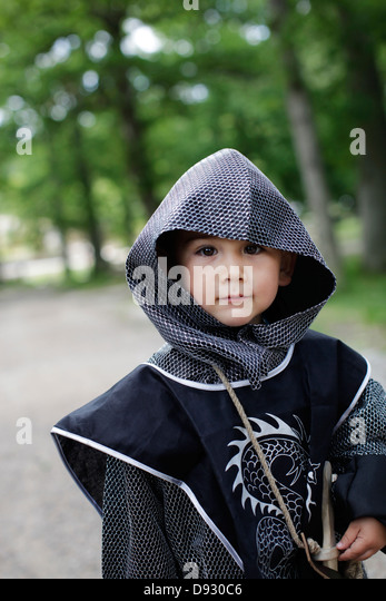 Boy wearing coat of mail - Stock Image