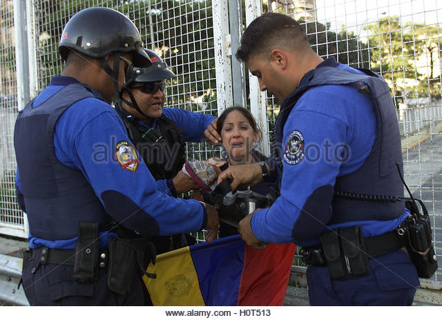 An opposition protester is helped by police in Caracas, January 14,  2003. One person was shot and injured in clashes - Stock Image