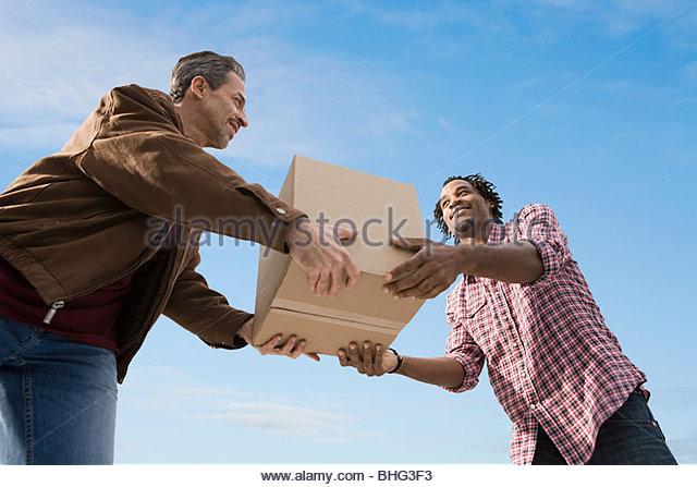Men with cardboard box - Stock Image