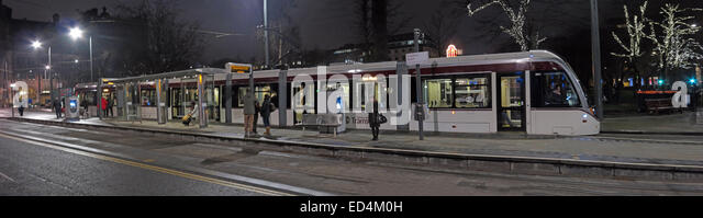 Panorama of New Edinburgh Tram bound for York Place, in St Andrew Square at night, Scotland, UK - Stock Image