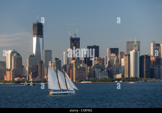 Lower Manhattan Skyline, Sailing Boat, East River, Freedom Tower, New York - Stock Image