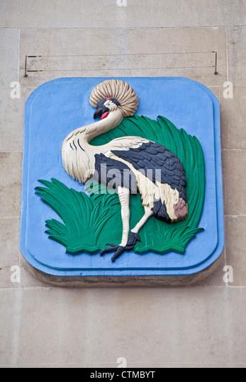 London Trafalgar Square The Ugandan national emblem of a crowned crane at Uganda House July 2012 - Stock Image