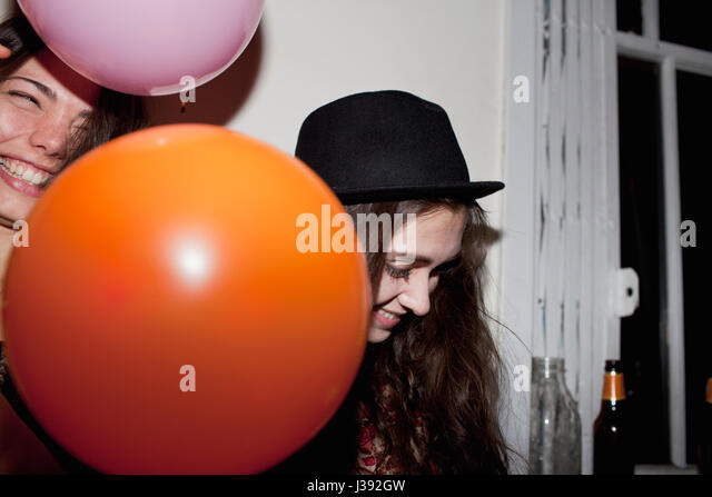 Friends hanging out at a party - Stock Image