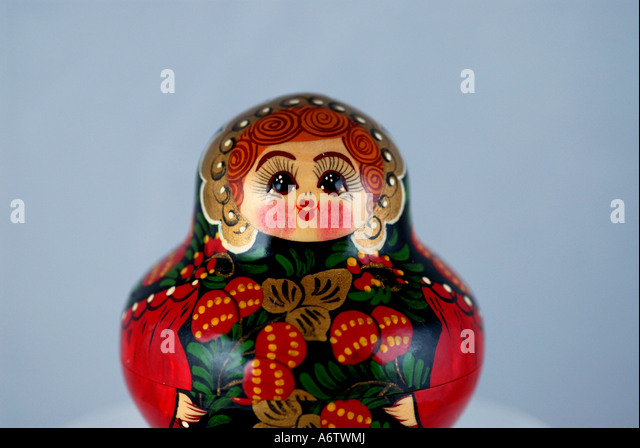 Russian nesting doll red squat painted flowers iconic russian souvenir moscow - Stock Image