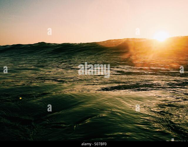 Sunlight over the sea - Stock Image