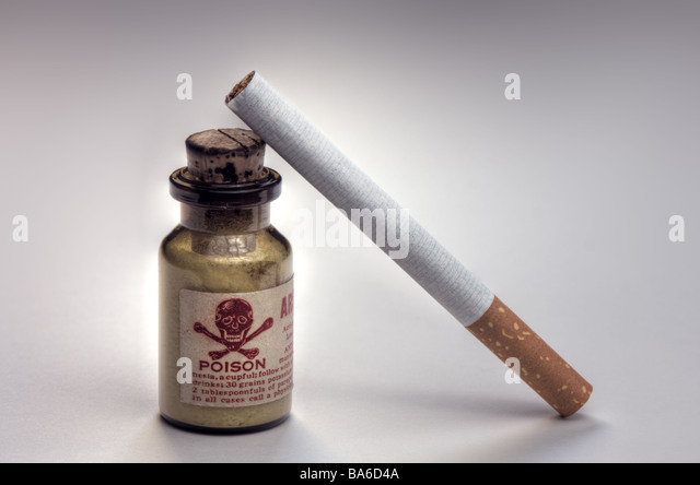 Cigarette and a bottle of poison - Stock Image