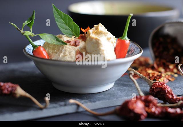 Houmous with chili flakes - Stock Image
