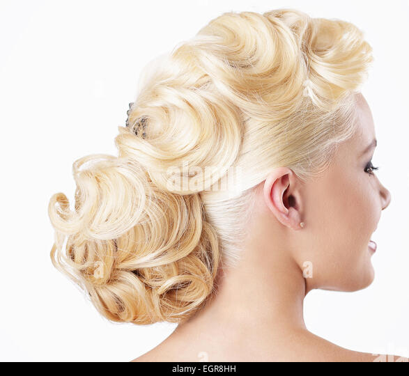 Elegance. Rear View of Blonde with Festive Hairstyle - Stock Image
